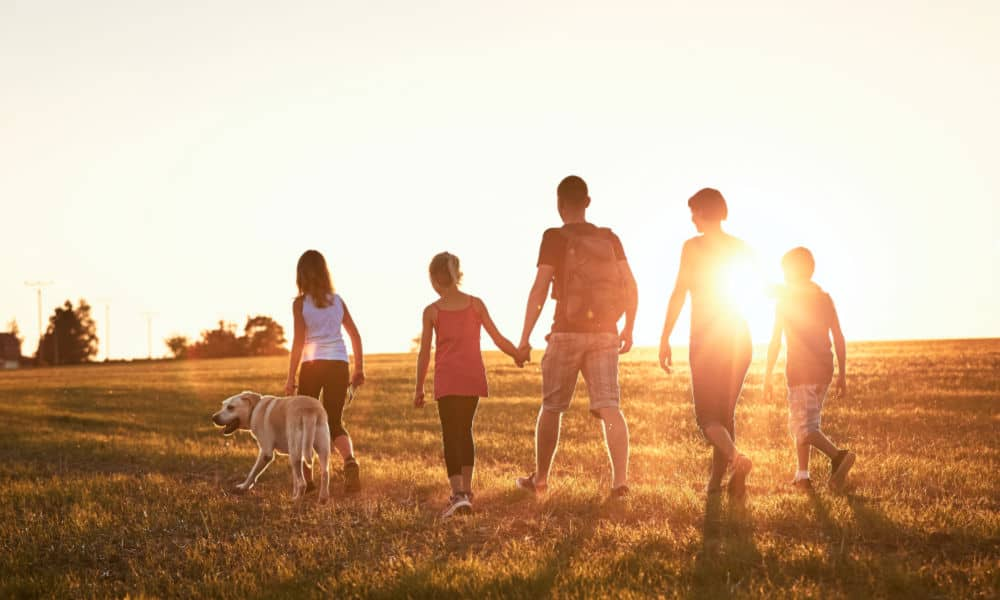 Trusting God with our Children (image of family walking outdoors)