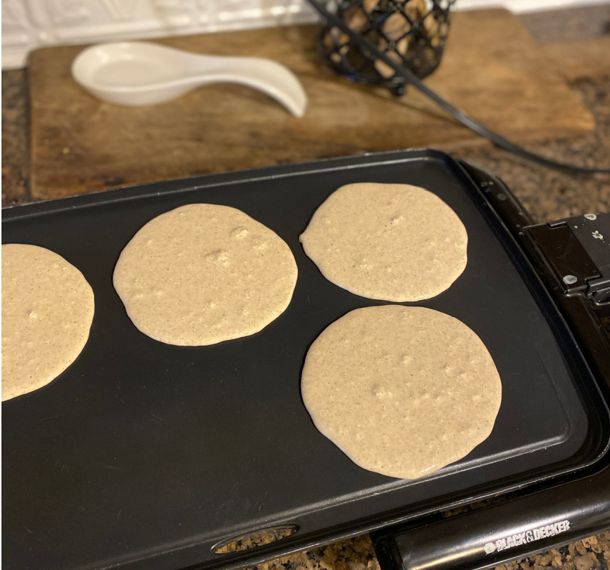 flour free oat pancakes on griddle