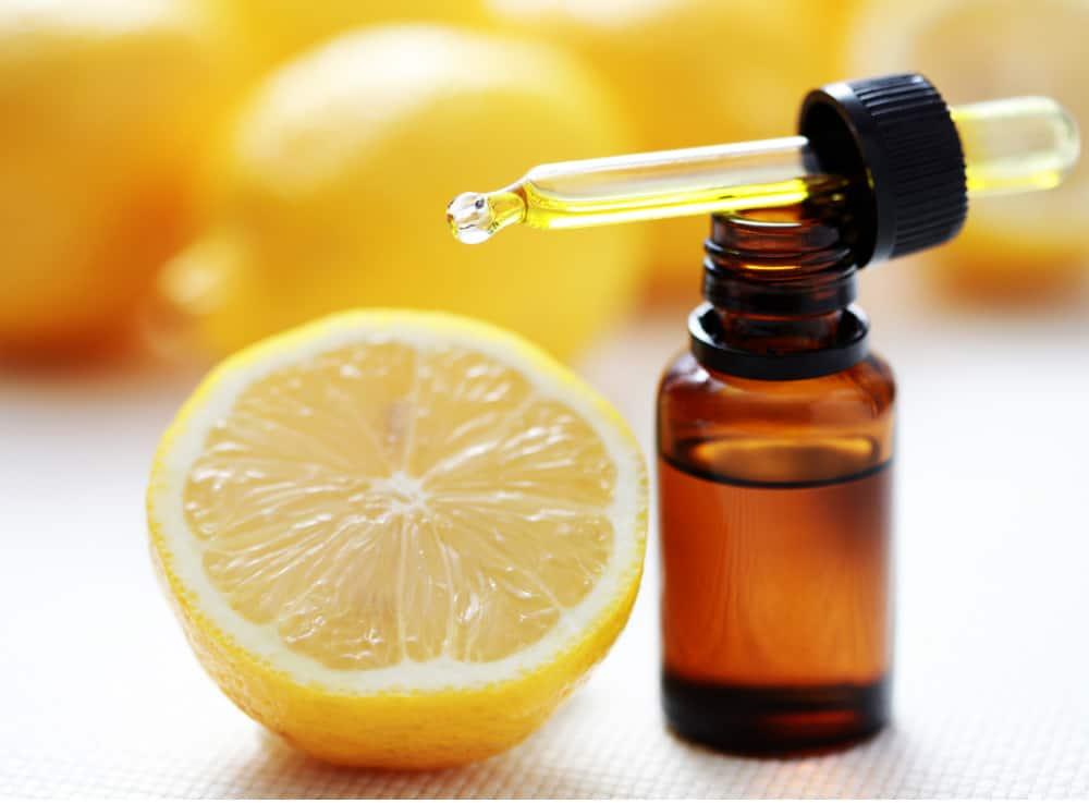 fresh lemon and bottle of lemon oil